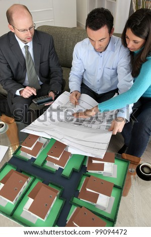 Young couple looking over new house plans
