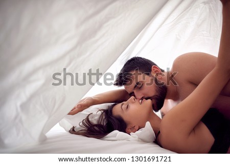 Young couple lovers having sex on a bed in morning with lust and love. Sex couple. Having sex.