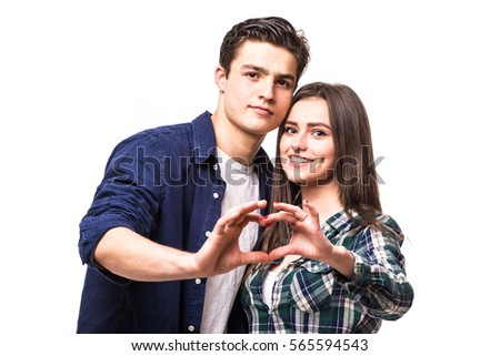 Young couple make heart symbol from their hands.