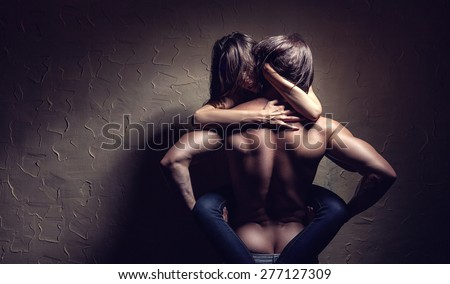 Young couple makes love to the wall