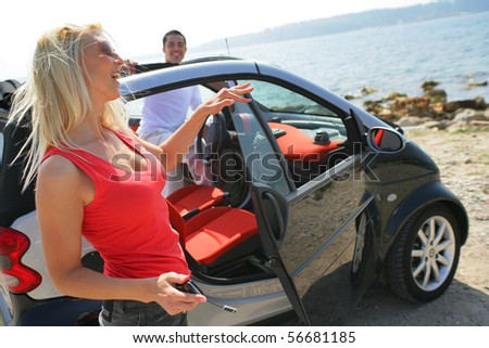 Young couple near a car