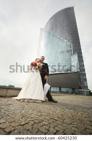 young couple near modern building