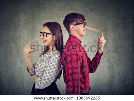 Young couple of cheaters, satnding back to back two liars
