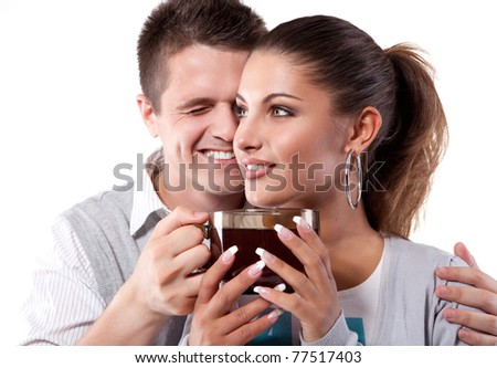Young couple of man and woman drinking tea