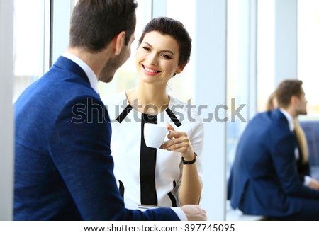 Young couple of professionals chatting during a coffee break #397745095