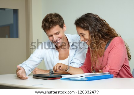 Young couple of students with digital tablet