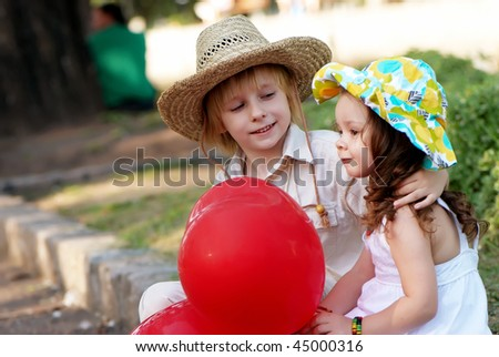 Young couple on avenue in park - stock photo
