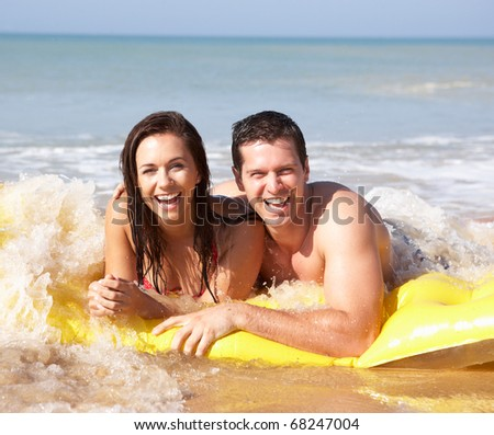 Young couple on beach holiday - stock photo