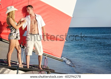 young couple on board of sea yacht