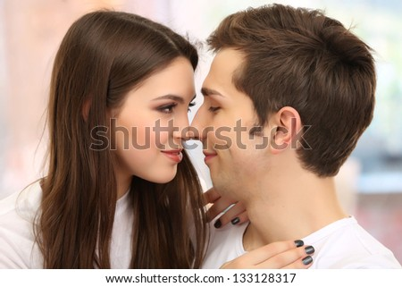 Young couple on bright background - stock photo
