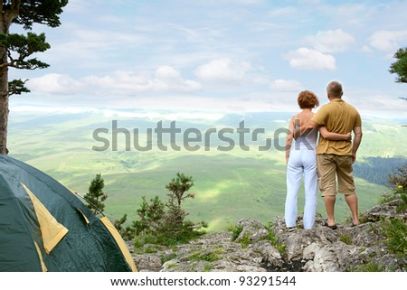 young couple on nature with tent