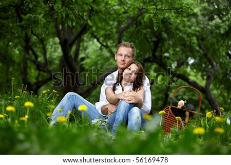 Young couple on picnic in a summer park