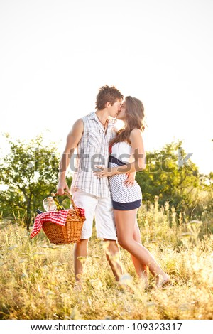Young couple on picnic, kissing