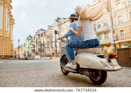 Young couple on scooter travel together transportation