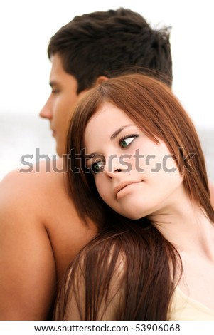 Young couple on the beach - stock photo