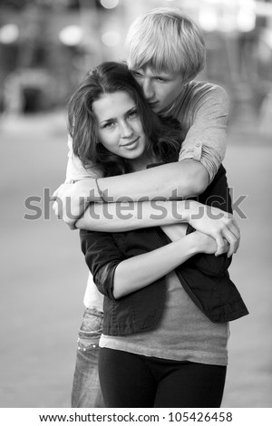 Young couple on the street of the city. Photo in black and white style.
