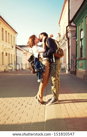 Young couple outdoor sweet kiss in summer - stock photo