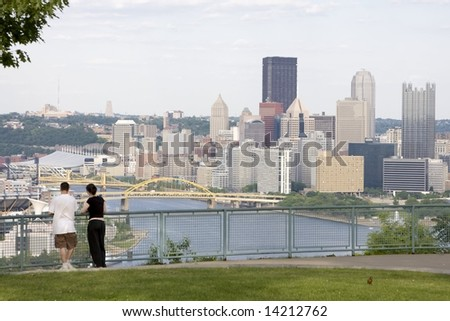 Young couple overlooking city view