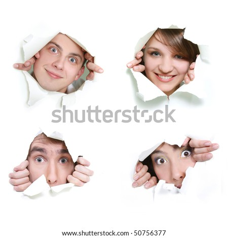 young couple peeping through hole in paper