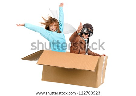 Young couple pilot flying a cardboard box isolated in white