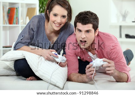 Young couple playing a video game together