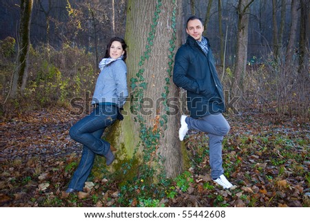 Young couple playing around in the nature - front view.
