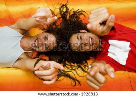 young couple playing on the bed