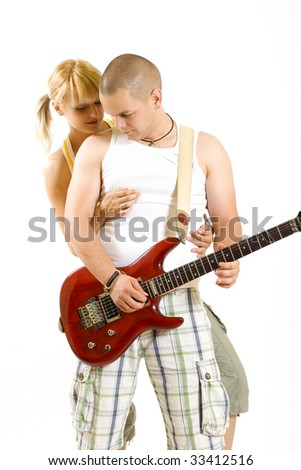young couple playing together an electric guitar