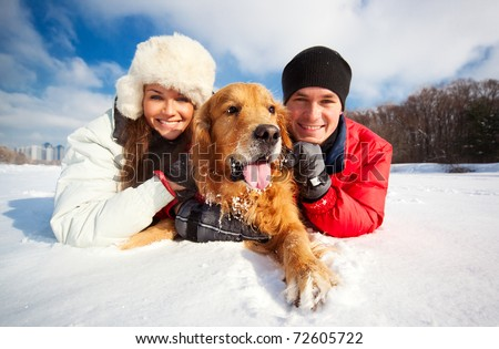 Young couple portrait with dog - stock photo
