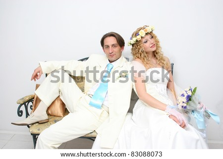 stock photo Young couple posing in a studio on the wedding day