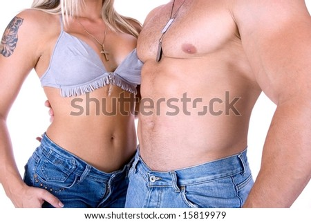 Young couple posing in jeans isolated on white