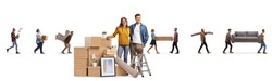 Young couple posing with packed cardboard boxes and other people carrying household items isolated on white background