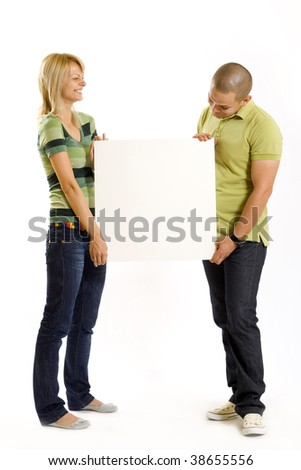 young couple presenting a blank board over white background