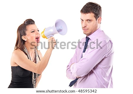 Young couple quarreling isolated against white background
