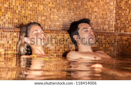 Young couple relaxing in a spa