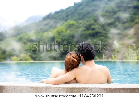Young couple relaxing in hot springs