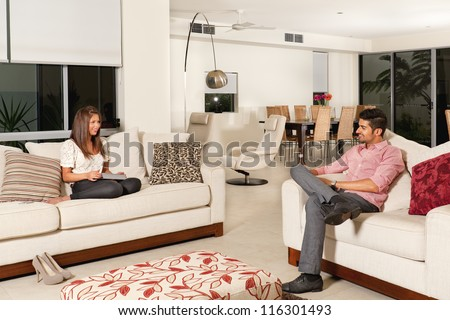 Young couple relaxing in modern living room stock photo for Living room ideas for young couples