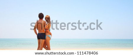 Young couple relaxing on a tropical beach