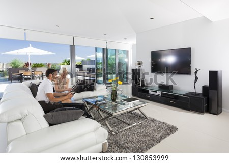 Young couple relaxing on couch in luxury living room #130853999