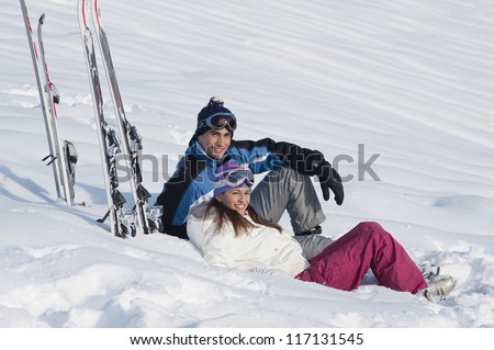 Young couple relaxing on the snow