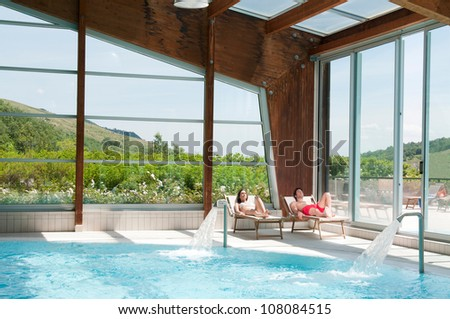 Young couple relaxing together in a beautiful spa centre