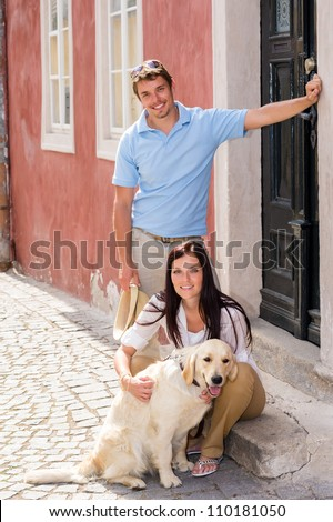 Young couple resting with dog on street stairs happy pet