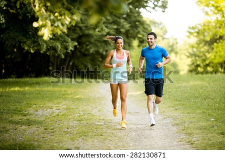 Photo of  Young couple running