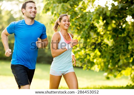Shutterstock Young couple running