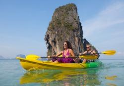 Young couple sea kayaking.