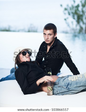 Young couple. Sea on the background