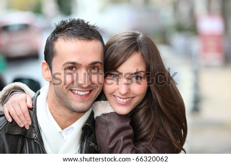 Young couple shopping in town in winter