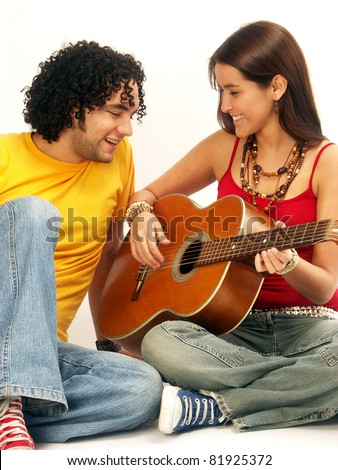 Young couple singing with a guitar.Playing guitar.