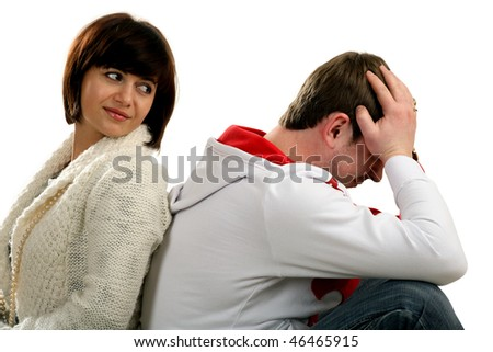Young couple sitting back to back , girl is looks like on a sad man
