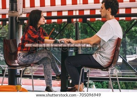 young couple sitting in a cafe...